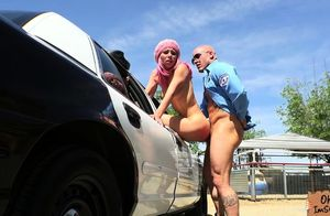 Aidra Fox plows a wolf arresting officer
