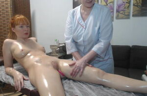 Mature doll doing  rubdown to bare lady